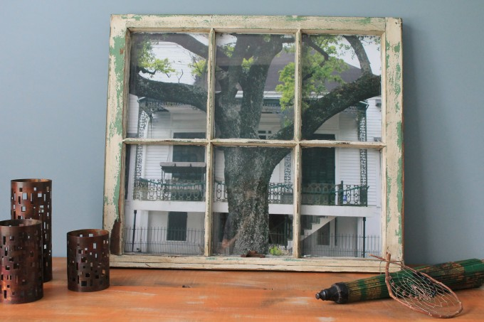 31x27 window, colors are ivory and green with a bit of stain, color and unedited photo taken in New Orleans on Esplanade Way.