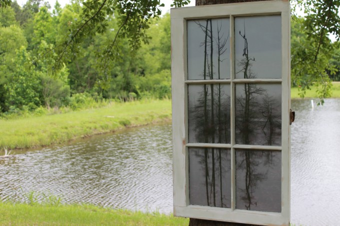 20x36 window, frame colors area very light green and white, natural light (taken in foggy conditions) unedited photo taken on the Tombigbee River.