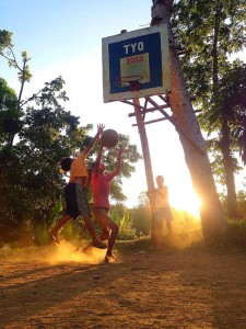 As the sun sets, the heat is still on with these kids playing their afternoon favorite game - basketball