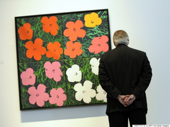 "A painting  titled ""Flowers"" by Andy Warhol during a press preview  April 30, 2010 at Sotheby's New York for their spring sales of Impressionist and Modern Art to be held May 5 and 6.  AFP PHOTO /TIMOTHY A. CLARY (Photo credit should read TIMOTHY A. CLARY/AFP/Getty Images)"