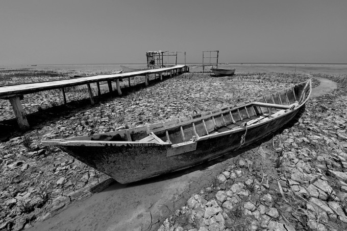 The lake is running dry due to dehydration and Only a narrow path for boats remained.