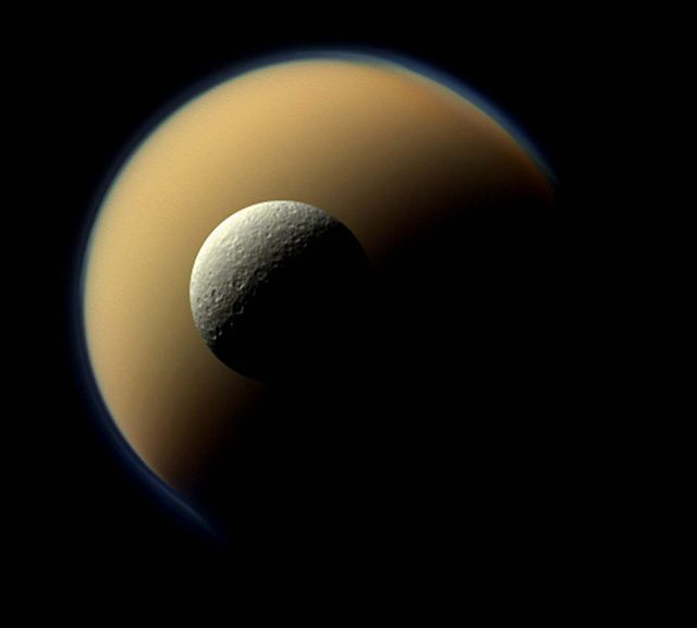 DECEMBER 23: In this June 16, 2011 photo distributed today,  Saturn's largest and second largest moons, Titan and Rhea, appear to be stacked on top of each other in a true-color scene from NASA's Cassini spacecraft. The images were taken using red, green and blue spectral filters that were combined to create this natural-color view. (NASA/JPL-Caltech/Space Science Institute)