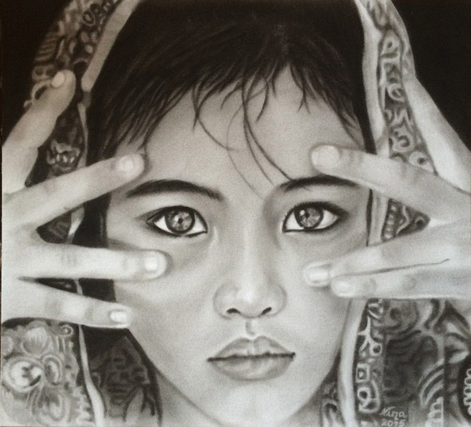 Indian girl with hands on face