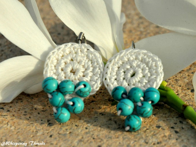 White crochet earrings with turquoise beads