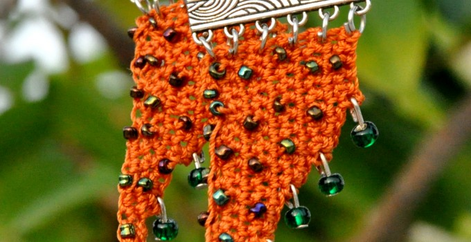 Rust crochet danglers with green accents