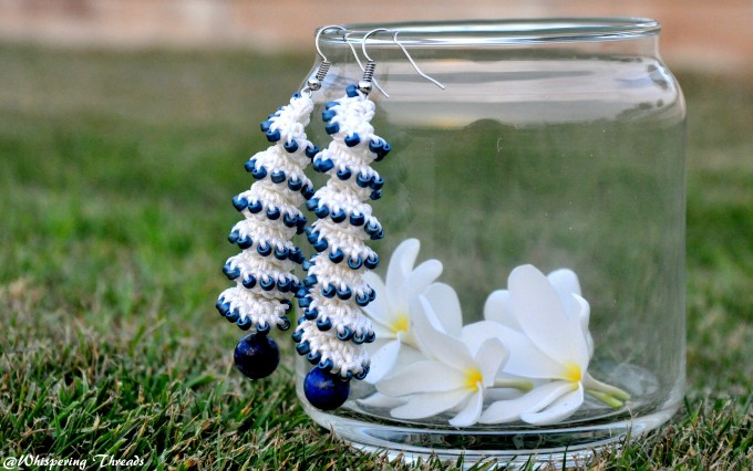 White spiral earrings with blue accents