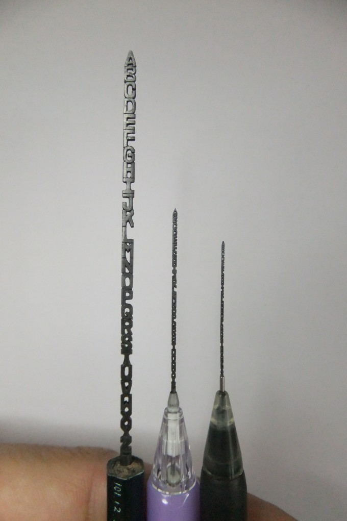 The letters from A to Z carved on 0.2cm/0.9mm/0.5 mm thick mechanical pencil lead.