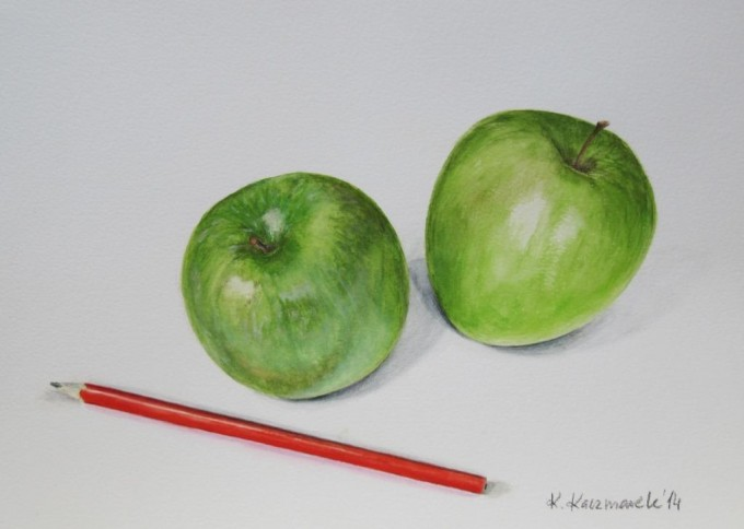Green apples and red pencil