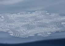 Simon Beck is creating snowart with a compass and snowshoes