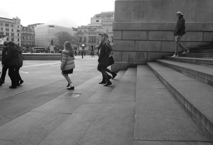 A girl notices me in while on a field trip in Trafalgar square, London.