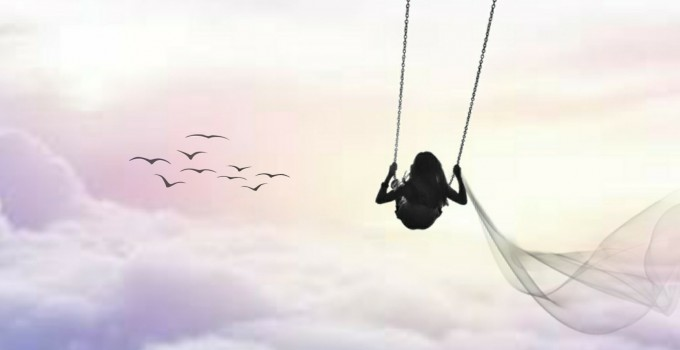 Girl on swing clouds