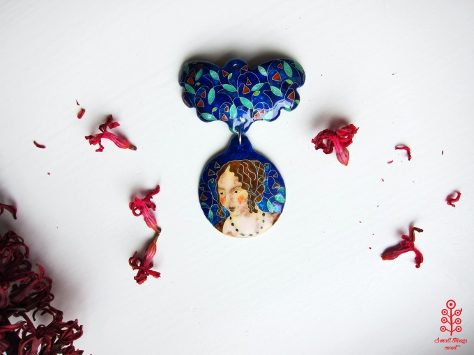 Enameled pendant by Small things count.