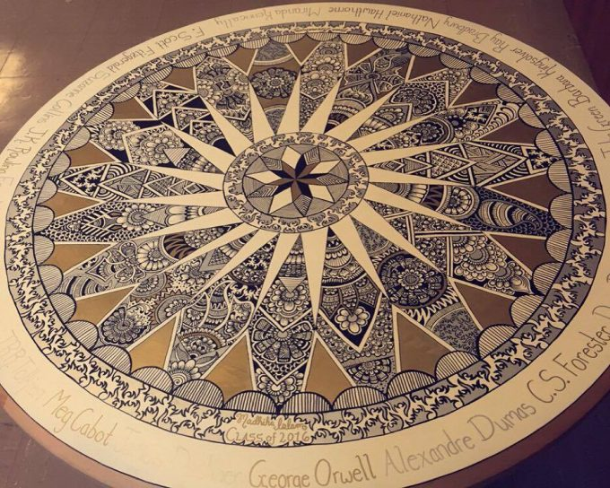 Table decorated by Madhiha Islam using paint markers.