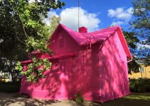 Olek covered Houses, sculptures, people, with crochet