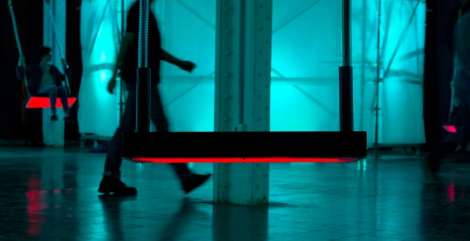 A person crosses the square of interactive swings