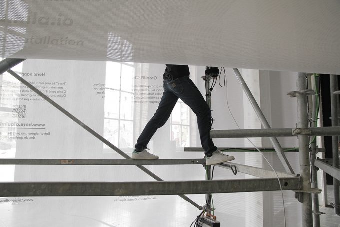 A member of the Col·lec team working on the installation's structure