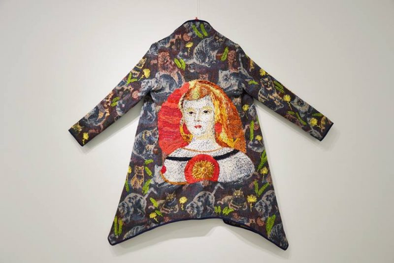 Textile coats with hand embroidery portraits.