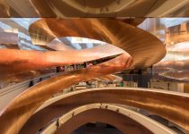 floating copper staircases intertwine at the main entrance of Copenhagen's new science and technology center
