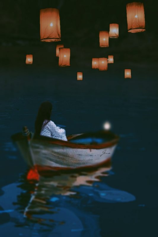 Girl on boat with flying lanterns