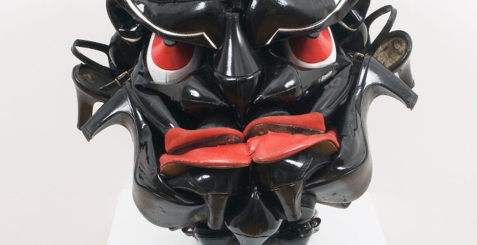 ArtistWillie Colejuxtaposes readymade footwear and African tradition in hisseries of sculptural masks.