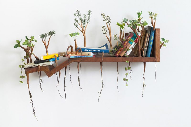 Artist Camille Kachani creates humorous wooden sculptures With Sprouted Wooden Limbs